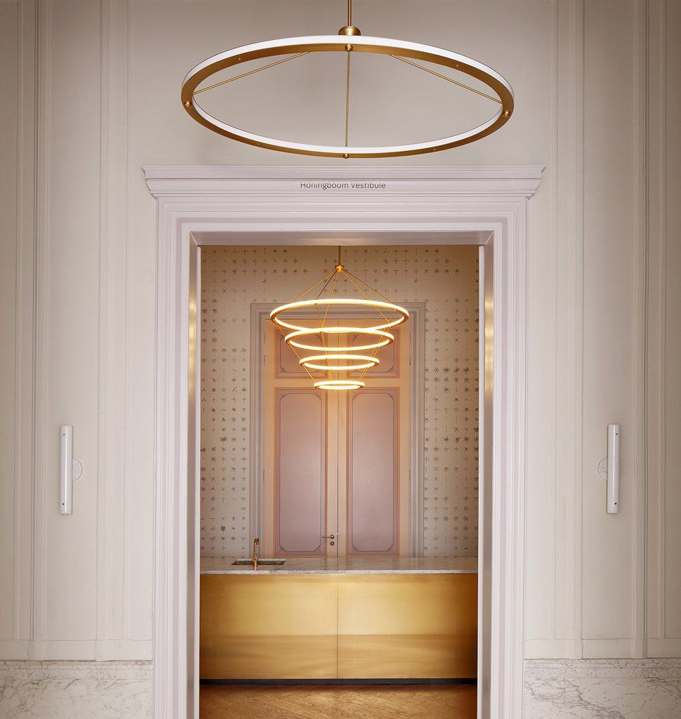 Circle Pendant (Brushed brass) and Chandelier - 4 Rings (Brushed brass) — Natura Artis Magistra, Amsterdam. Courtesy of BigBrands and Studio Linse