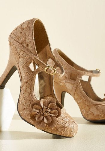 Call on these lace heels by Ruby Shoo the moment you have an elegant adventure in mind! Always ready to romp with their square cutouts, architectural trim, gorgeous floral appliques, and touches of metallic gold, these bronze pumps are ones you can rely on for an inspired frolic.
