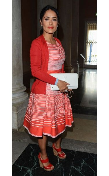 "Salma Hayek in a Carolina Herrera dress and Yves Saint Laurent clutch at the ""La Voce Delle Immagini"" exhibition, Venice"