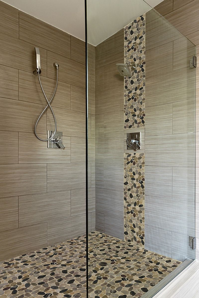 Nice Use Of Pebble Tiles On The Floor And Running Up The Shower Head Wall Bathroom Remodel Shower Shower Remodel Bathroom Decor