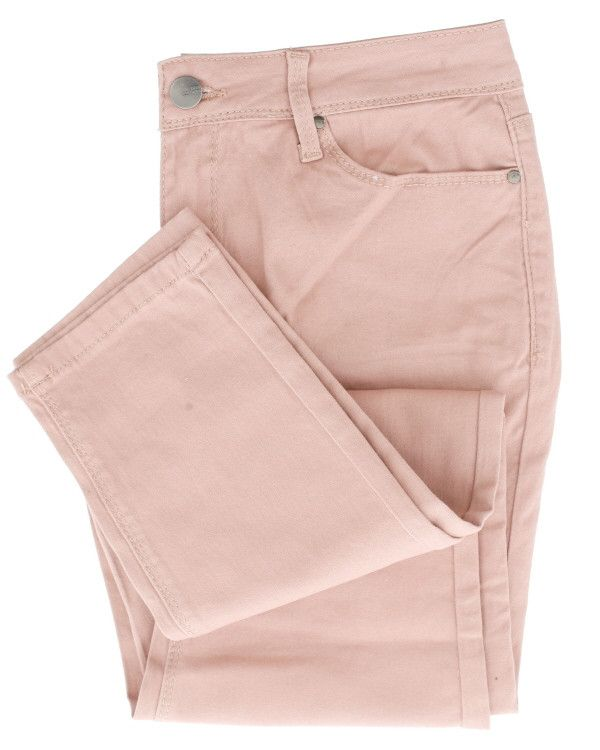 Skinny fit jeans and dressed in pink