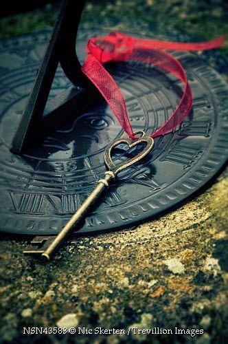 Trevillion Images - key-with-ribbon-on-sundial