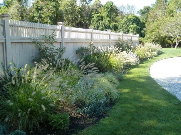 If your dog has a well worn path along the fence, a landscaped border may help to change the pattern. Choose tough specimens like ornamental grasses and native shrubs. These plants may help divert your pup's activity, and will hold up to occasional leaps and bounds.