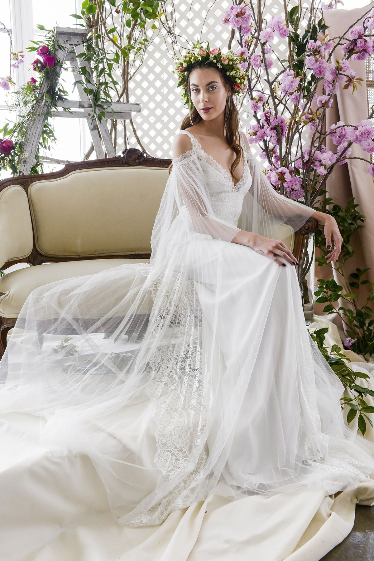 Gorgeous wedding dress with tulle sleeves and dramatic train