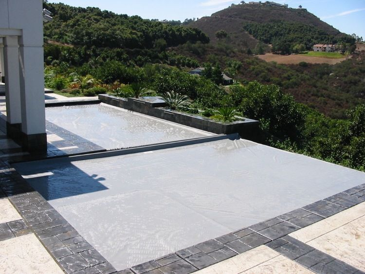 Automatic swimming pool safety covers 18775767498