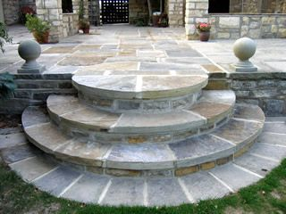 Seamless integration of stone paving and steps into the existing terrace