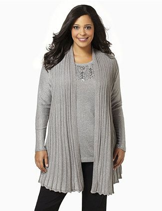 Sparkle in the spotlight with this knit sweater. Metallic lurex yarn shines along the ribbed, fitted fabric. Includes padded shoulders an a scalloped trim at the hem. Catherines tops are perfectly proportioned for the plus size woman. catherines.com