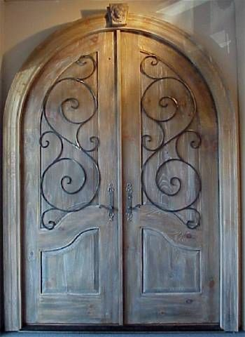Arch top double entry solid wood door with custom scrollwork ...