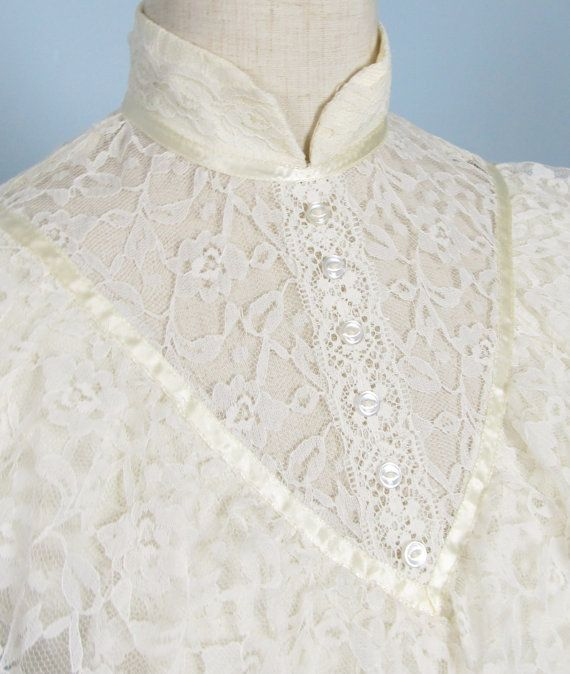 Vintage 1970s Creme Lace Gunne Sax Style Dress!    Label: Union Made  Size: Small, modern day size 4/6  Measurements: 34 inch bust, up to a 28 inch waitline, open hips, 56 inches in length    Victorian style  Lace and satin fabrics  Ribbon detail with button in front  Ties in back  Long length Lace sleeves    Great vintage condition!  *one repaired flaw on hem, hardly noticeable when worn