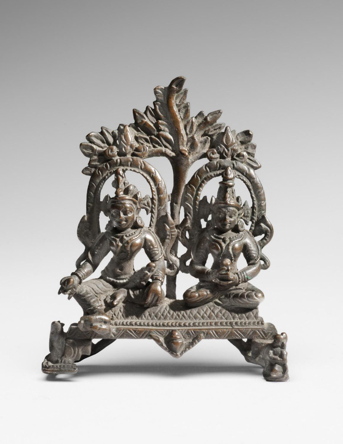 Philadelphia Museum of Art - Collections Object : Gomedha Yaksha and Ambika Yakshi, Attendants of the Jina Neminatha. Geography: Made in Bihar, India, Asia Date: 12th - 13th century Medium: Bronze Dimensions: 3 1/2 x 3 x 1 inches (8.9 x 7.6 x 2.5 cm) Curatorial Department: South Asian Art Object Location: Currently not on view  Accession Number: 1994-148-179 Credit Line: Stella Kramrisch Collection, 1994