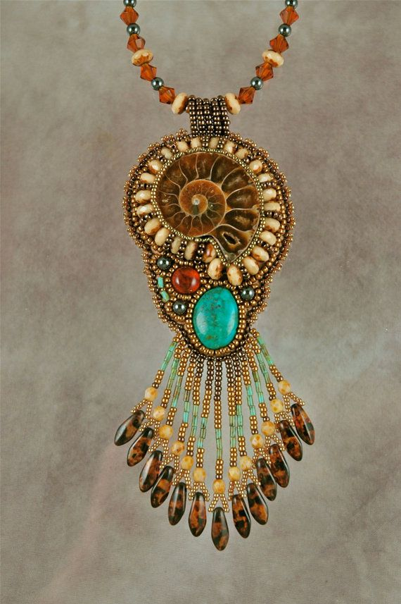 Ammonite with turquoise and amber bead embroidered by
