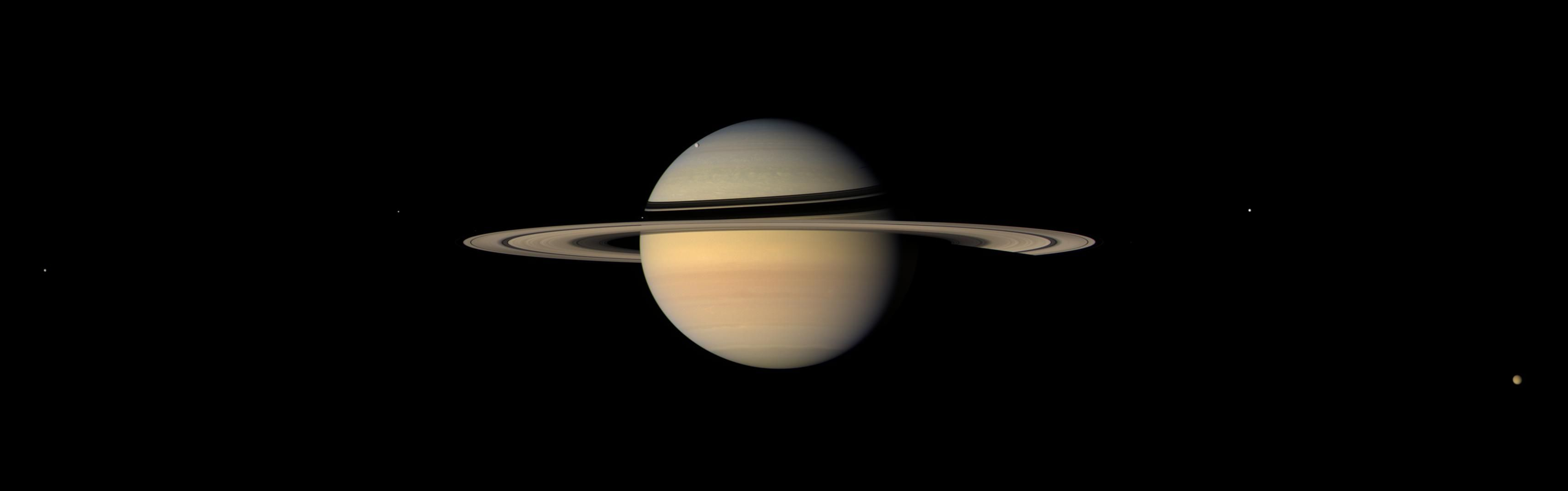 Six Saturn moons are visible in this image snapped by NASA's Cassini probe in September 2007, including Titan at the lower right.