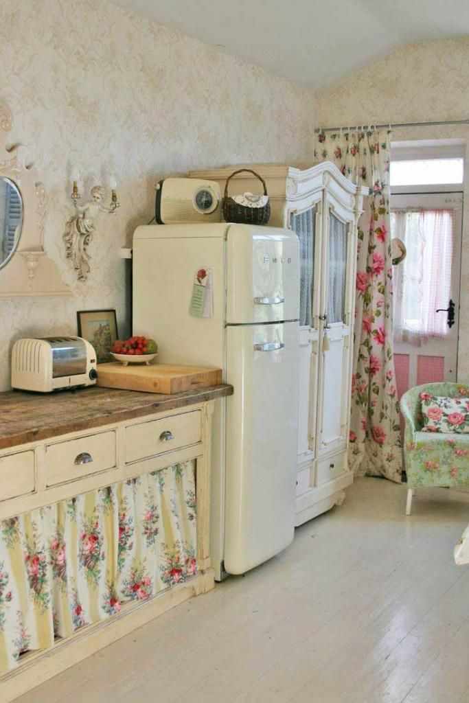 Hard Not To Picture A Sweet Little Rose Cottage Here Floral Curtains Armoire In The Kitchen Shabby Chic Kitchen Chic Kitchen Decor Shabby Chic Kitchen Decor