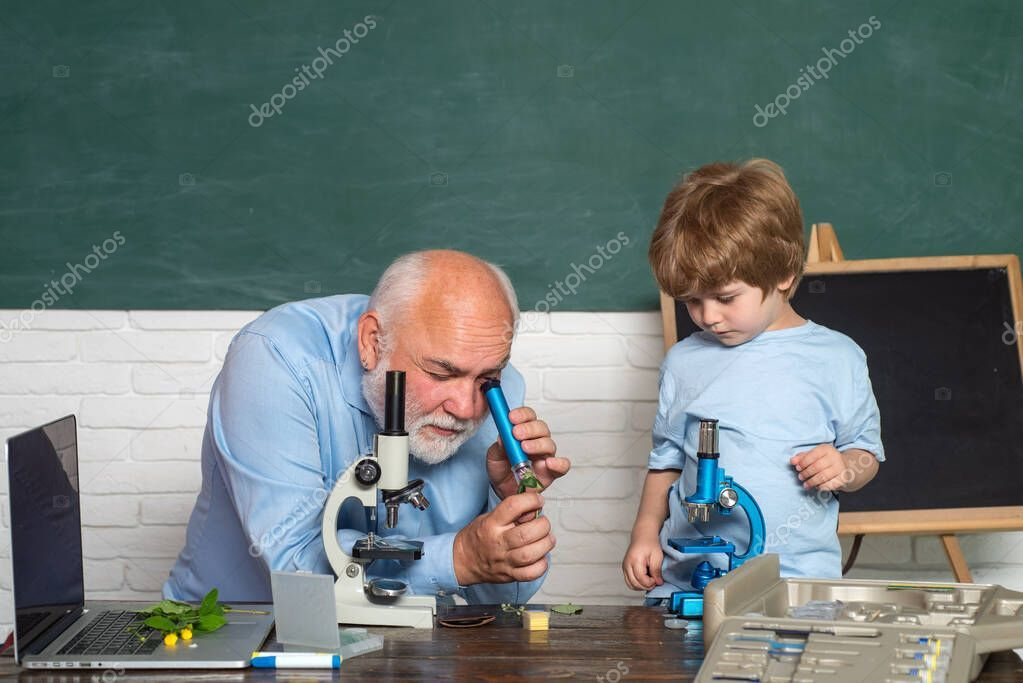 Back to school and happy time. Funny teacher in the classroom. Lab microscope an