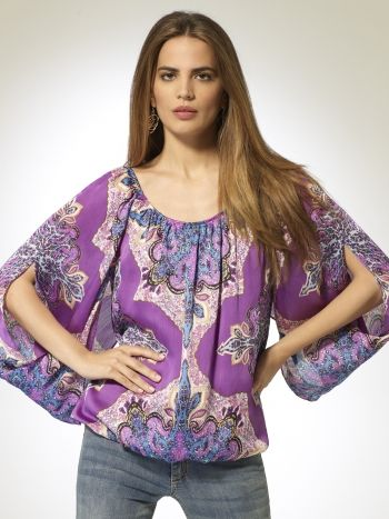 Scoop neck printed blouse with bubble hem. Draped sleeves. 100% polyesterImportMachine wash