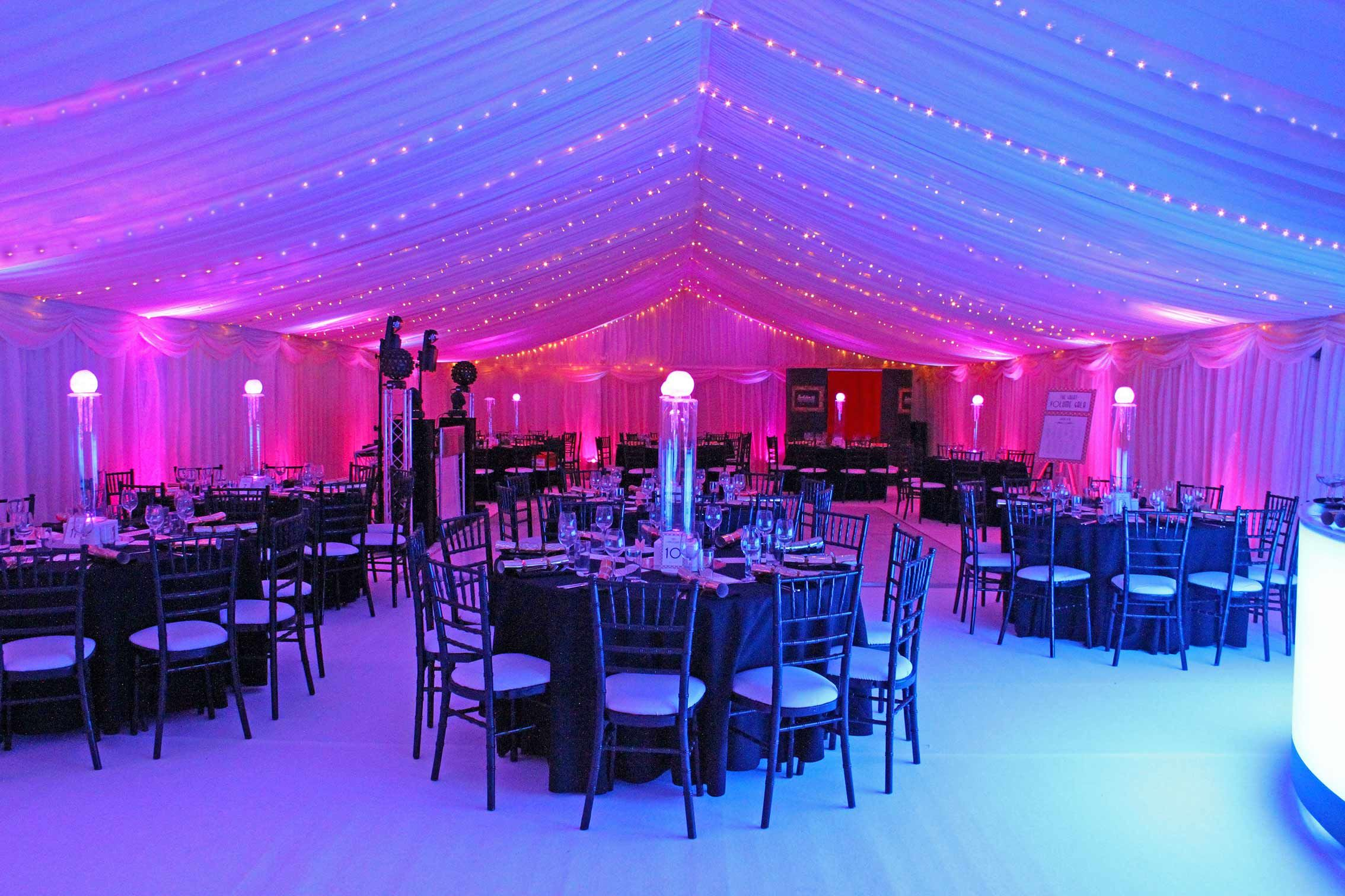 marquee interior with fairy lights, blue and pink lights and black