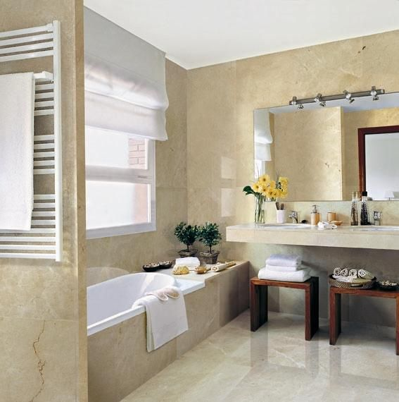 Marble can make even a small bathroom look chic and - Best paint color for crema marfil bathroom ...