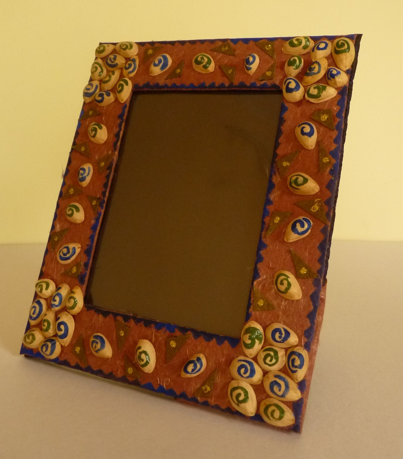 This picture frame is made from courier cardboard and pista shells