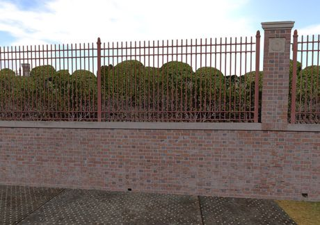 Iron Fence Atop A Brick Wall For Aesthetics And Security With