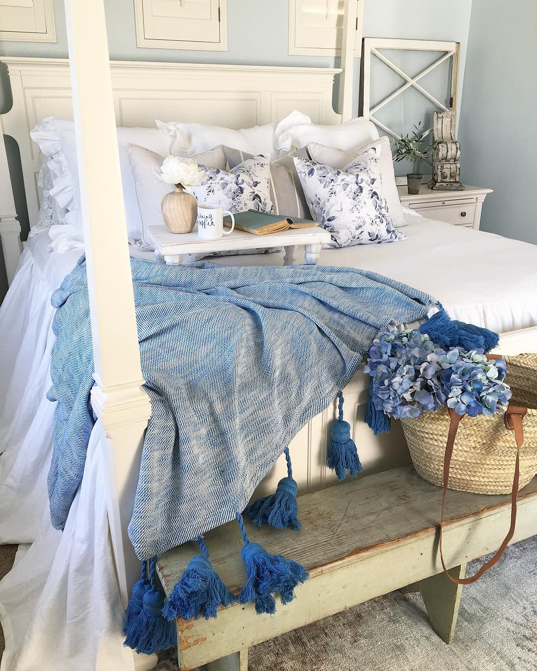 White Bedding On Cream Four Poster Bed With Blue Throw And