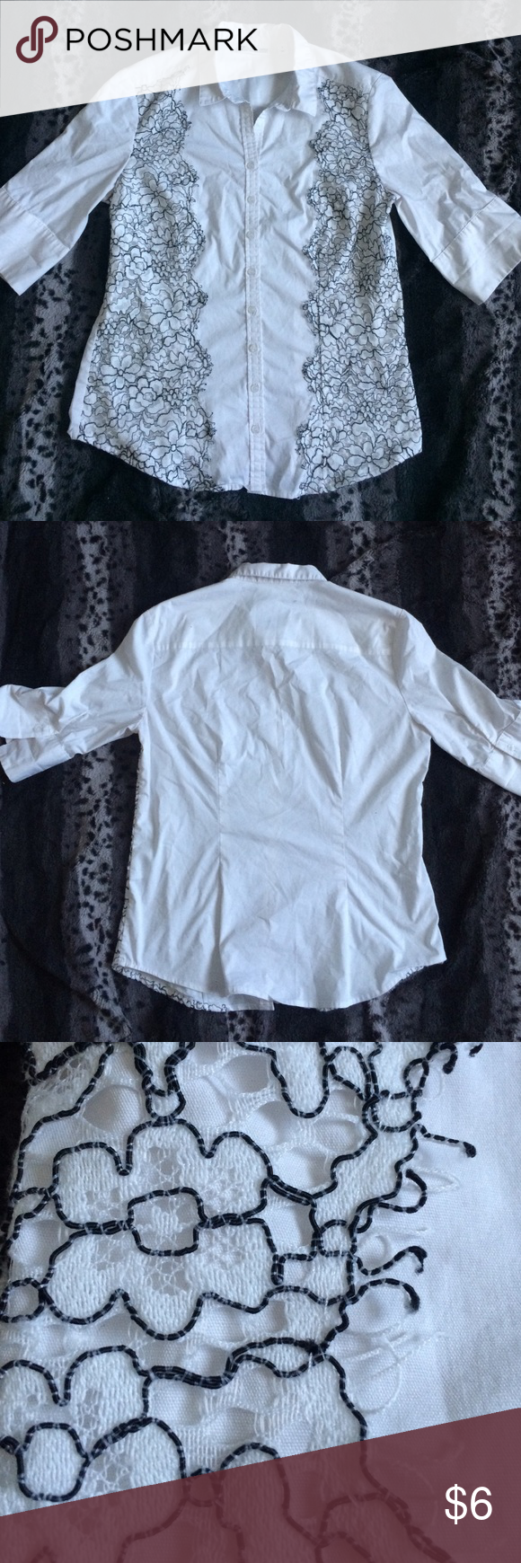 White Blouse Black lace along either side of the front. No stains. New York & Company Tops Blouses