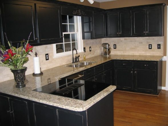 black cabinets kitchen. Kitchen  Simple Design With Wooden Flooring Looks More Elegant By Applying Black Cabinet Plus Marble Backsplash Also Granite Counter venetian gold granite countertops on black cabinets Future home
