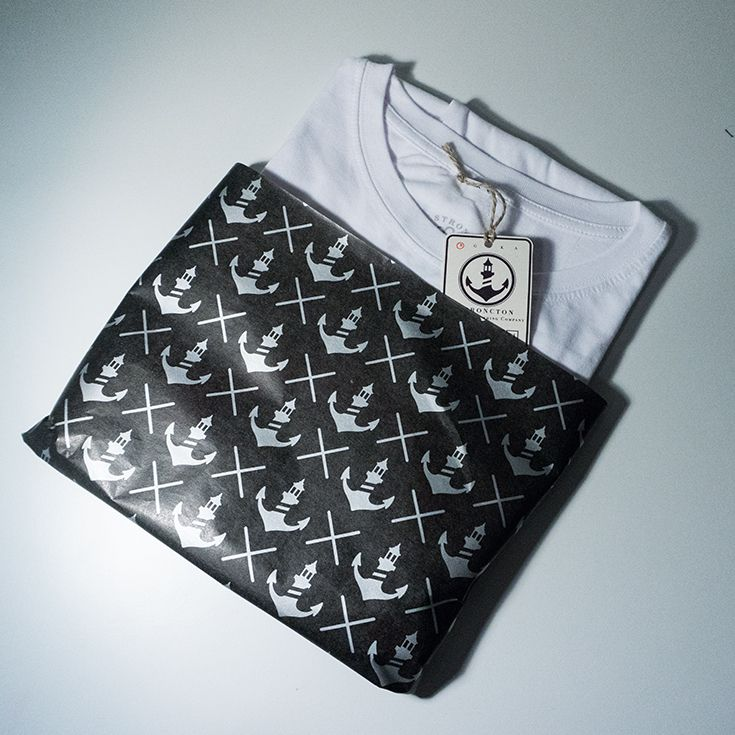 nicely packaged t-shirt in our exclusive branded tissue paper. N I C E