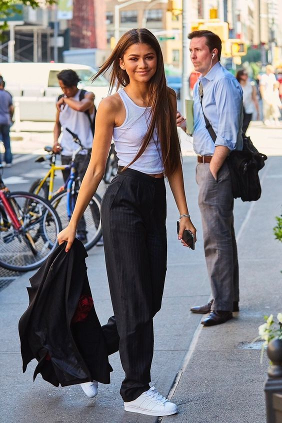 19 Zendaya Street Style Photos Street style by Zendaya White sneakers and suit became classical outfit fot work
