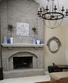White shelves and Brick fireplace