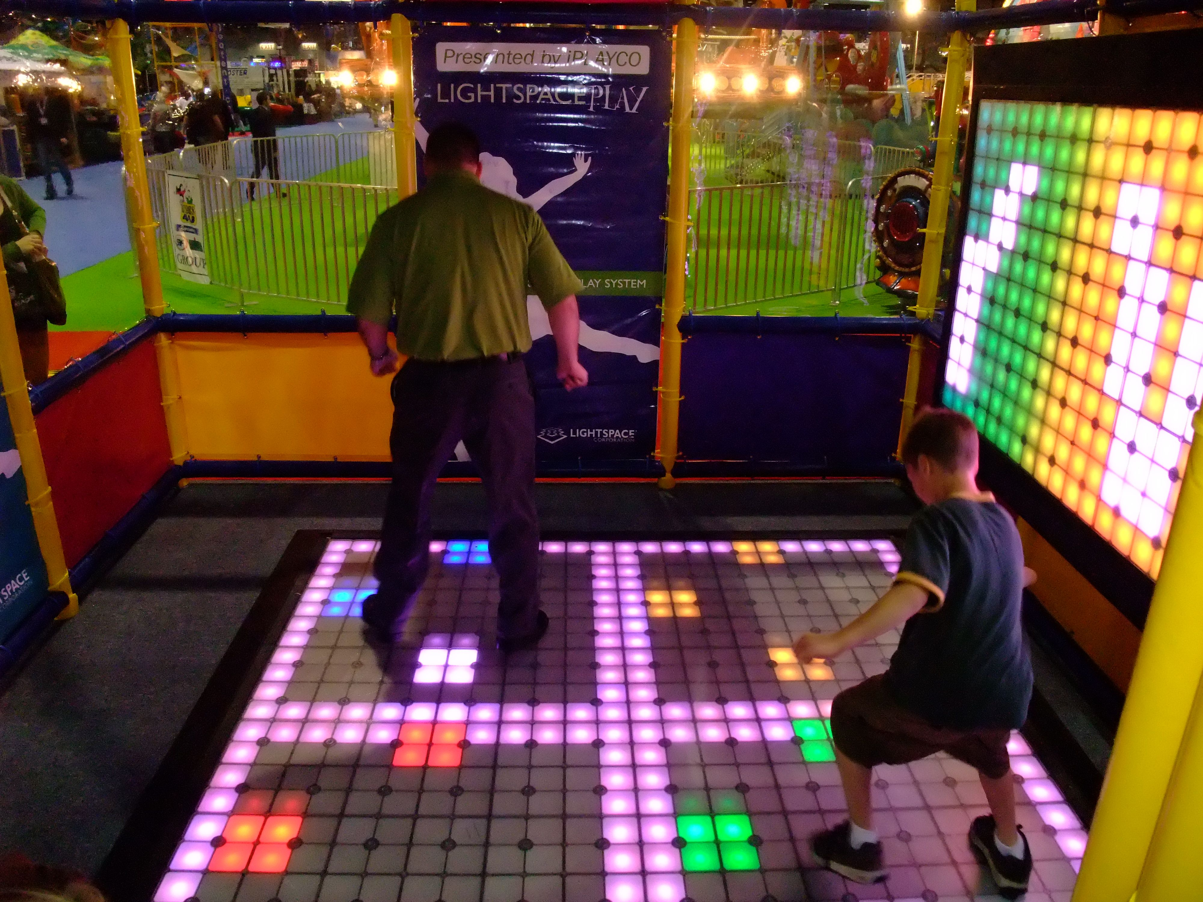 Trade Show Booth Game Ideas : Iaapa trade show in quantum themed lightspace floor