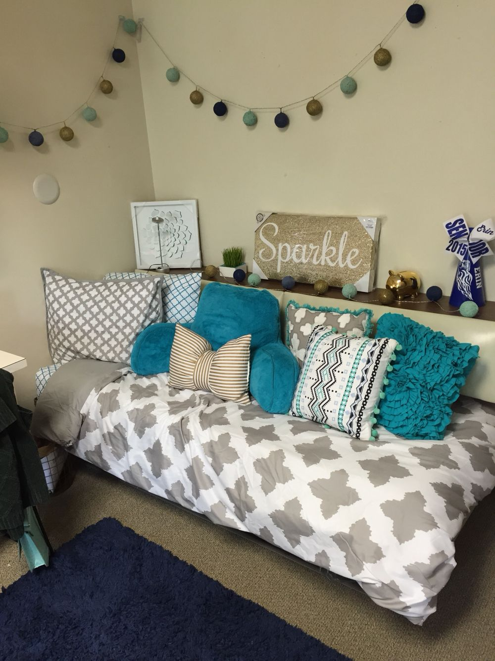 grey teal dorm room with navy, mint, & gold accents