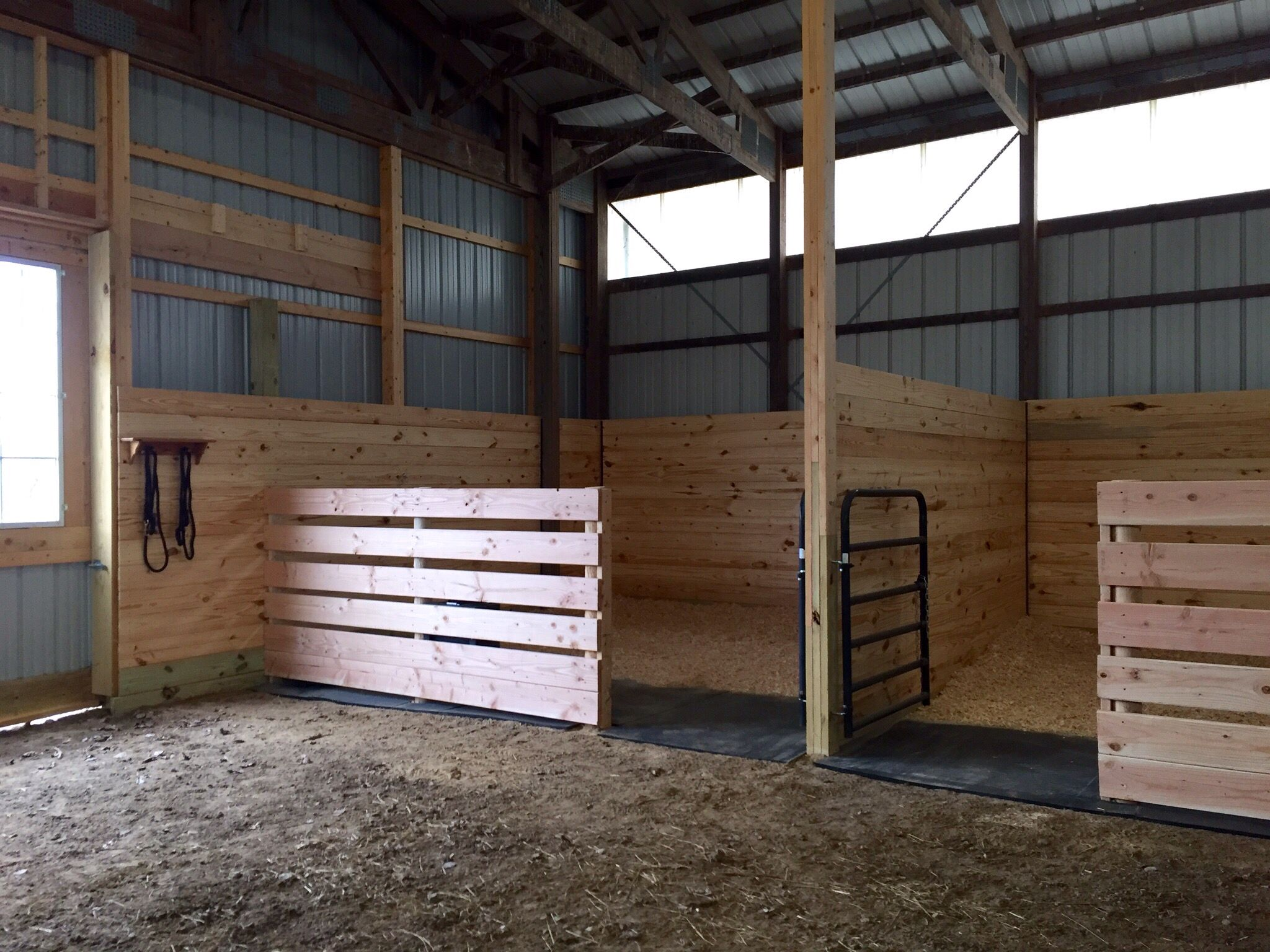 Easy inexpensive horse stalls at the end of an arena til i for Horse stall door plans