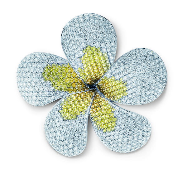 Pavé set yellow and white diamond brooch with articulated petals set in 18kt white gold. Also converts into a pendant.