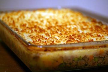 American favorite shepherd's pie recipe, casserole with ground beef, vegetables such as carrots, corn, and peas, topped with mashed potatoes.