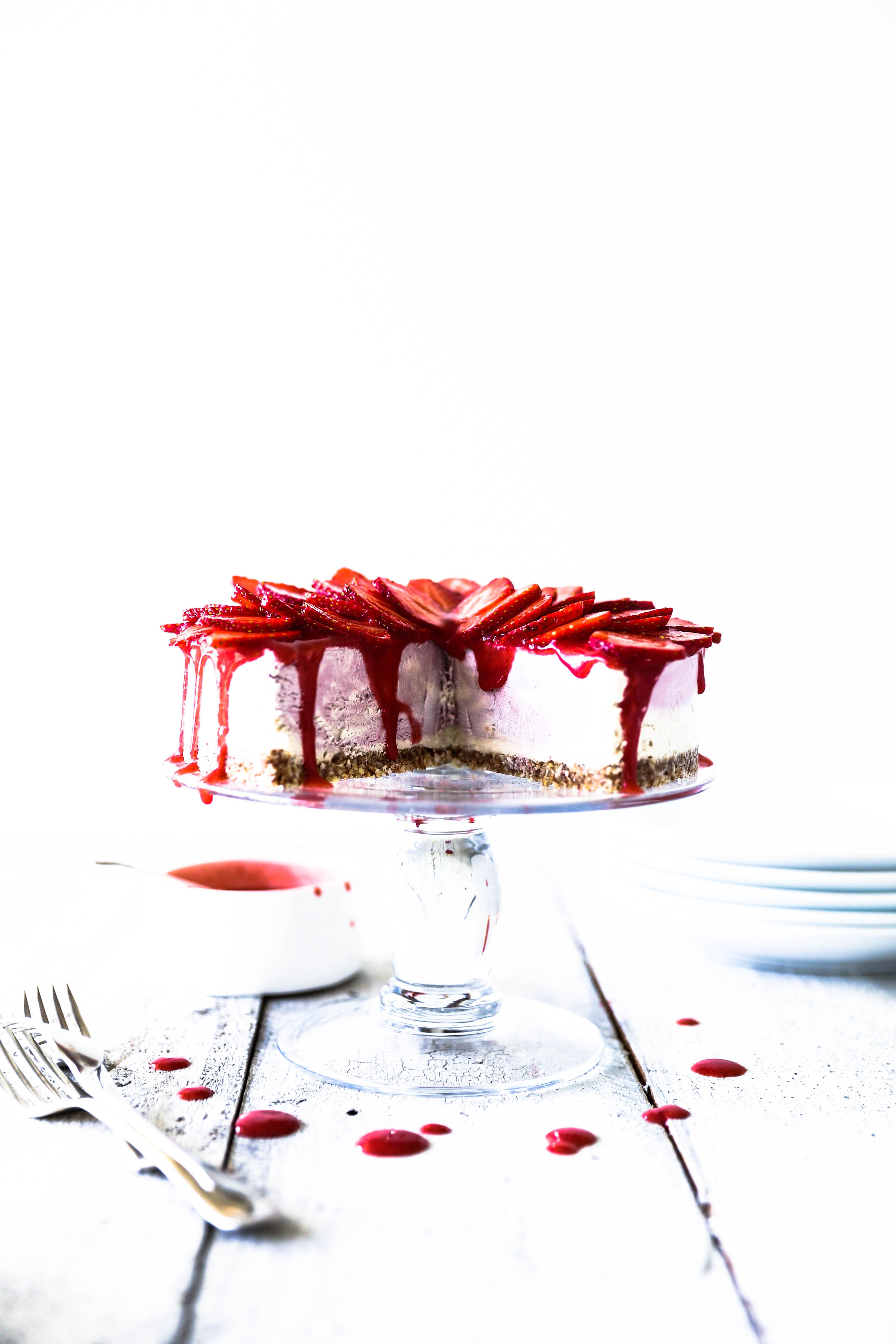 Raw strawberries cream ice cream cake strawberries and