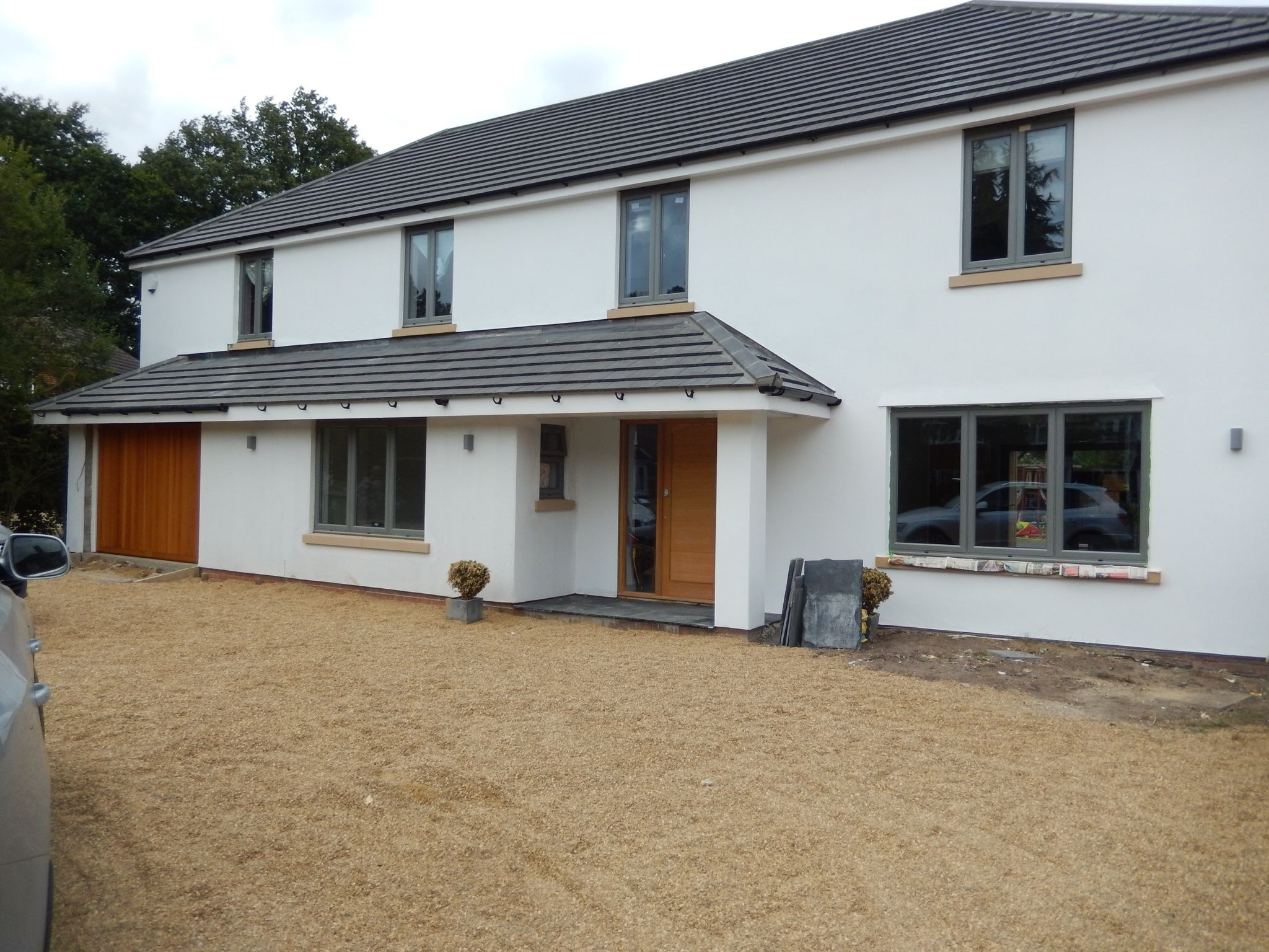 After Picture White Rendered House With Grey Windows And