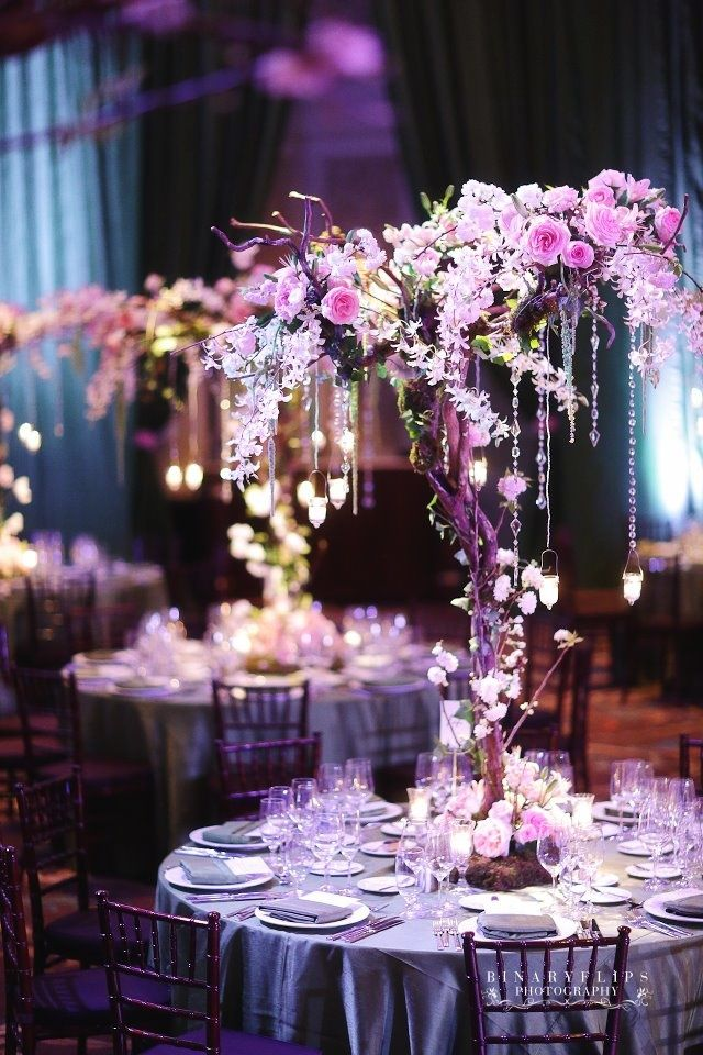 Whimsical Wedding Centerpieces Designed By Raining Roses Orlando I Like That It Doesn T Block Views Stuff Hangs Would Do Purple Color Scheme