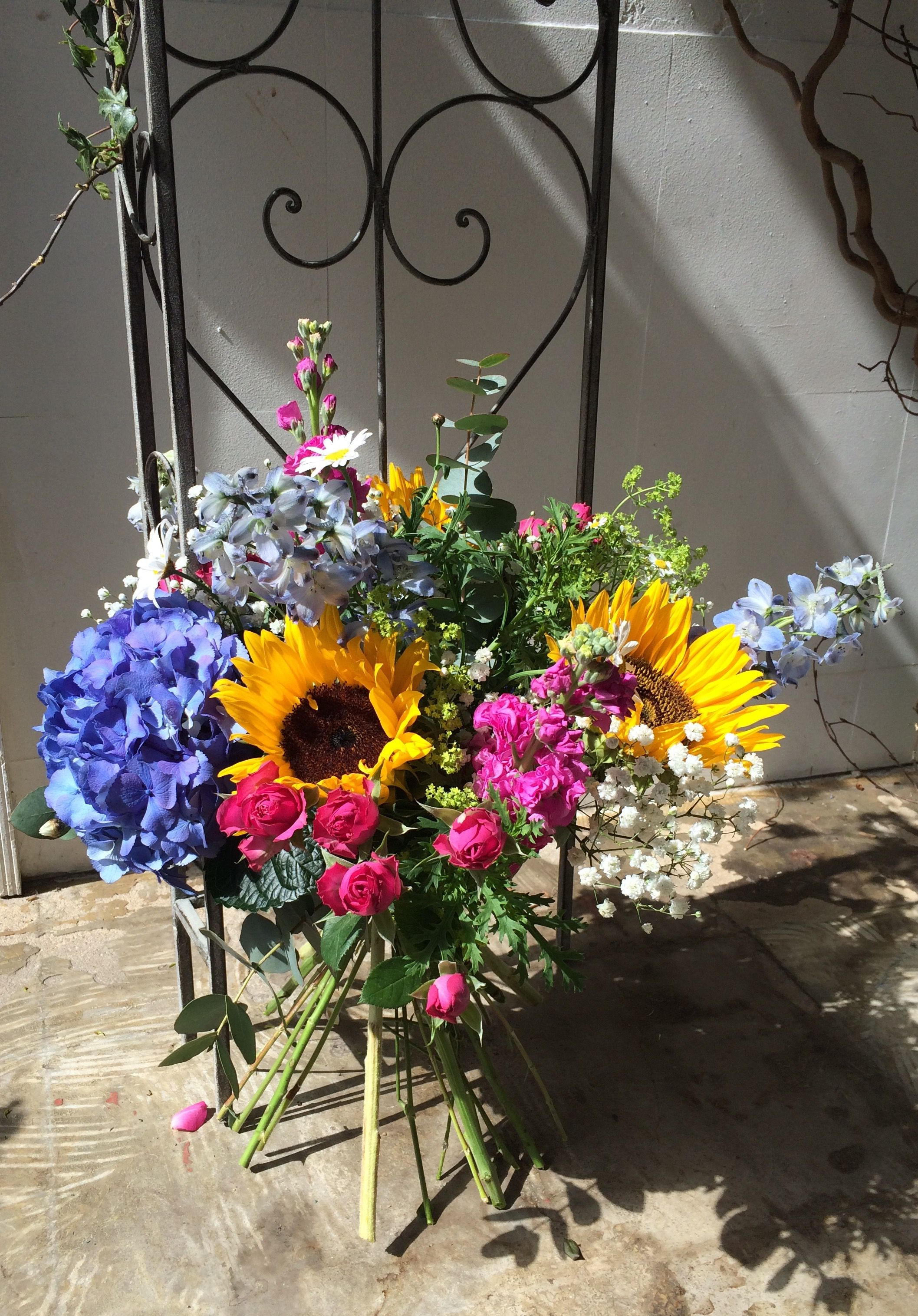 Hindu wedding decoration ideas  Summery handtied bouquet bright and colourful with sunflower