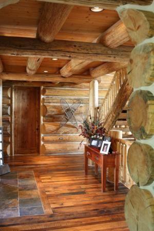 Slate tiles in entry butted up against the darker hardwood for Log cabin floors