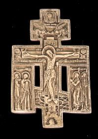 """Russian Triple Cross    This precious early 19th century Orthodox cross tells the story of the Crucifixion with panels of the Blessed Virgin, St. Mary Magdalen, St. John and St. Longinus the Soldier on either side. God the Father is shown above, with Jerusalem in the background and the lance and sponge by the Crucified Christ. The sun and moon are depicted and the inscription reads: """"Lord, we bow before thy cross and we glorify thy resurrection."""""""