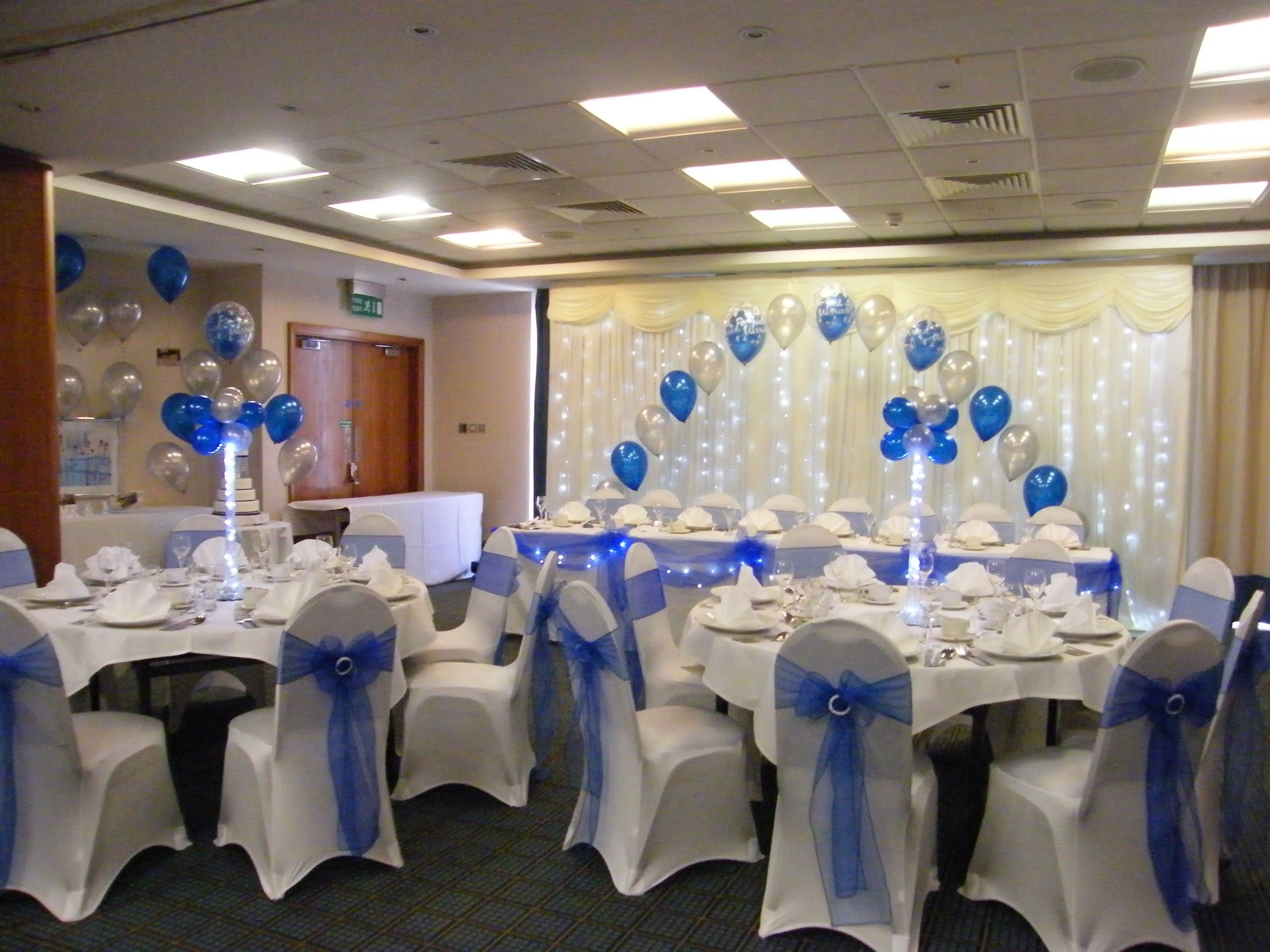 Wedding venue decorations chair covers balloons and table centre