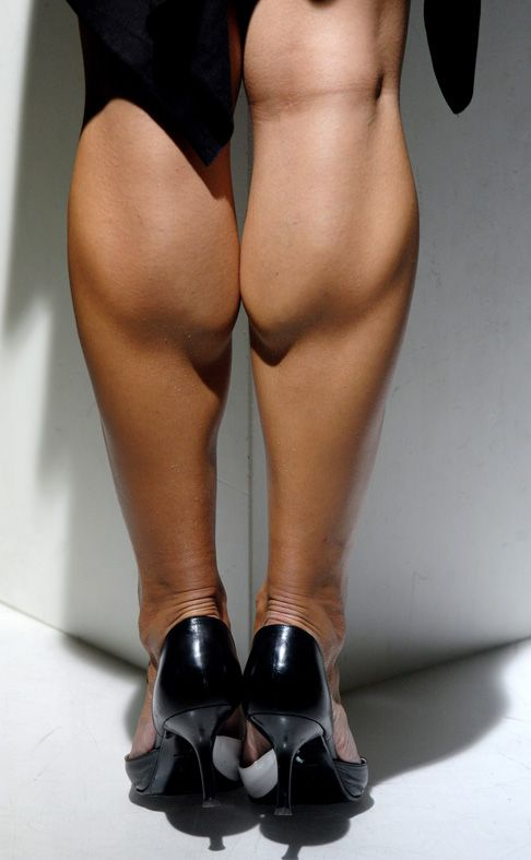 Escort with muscular calves