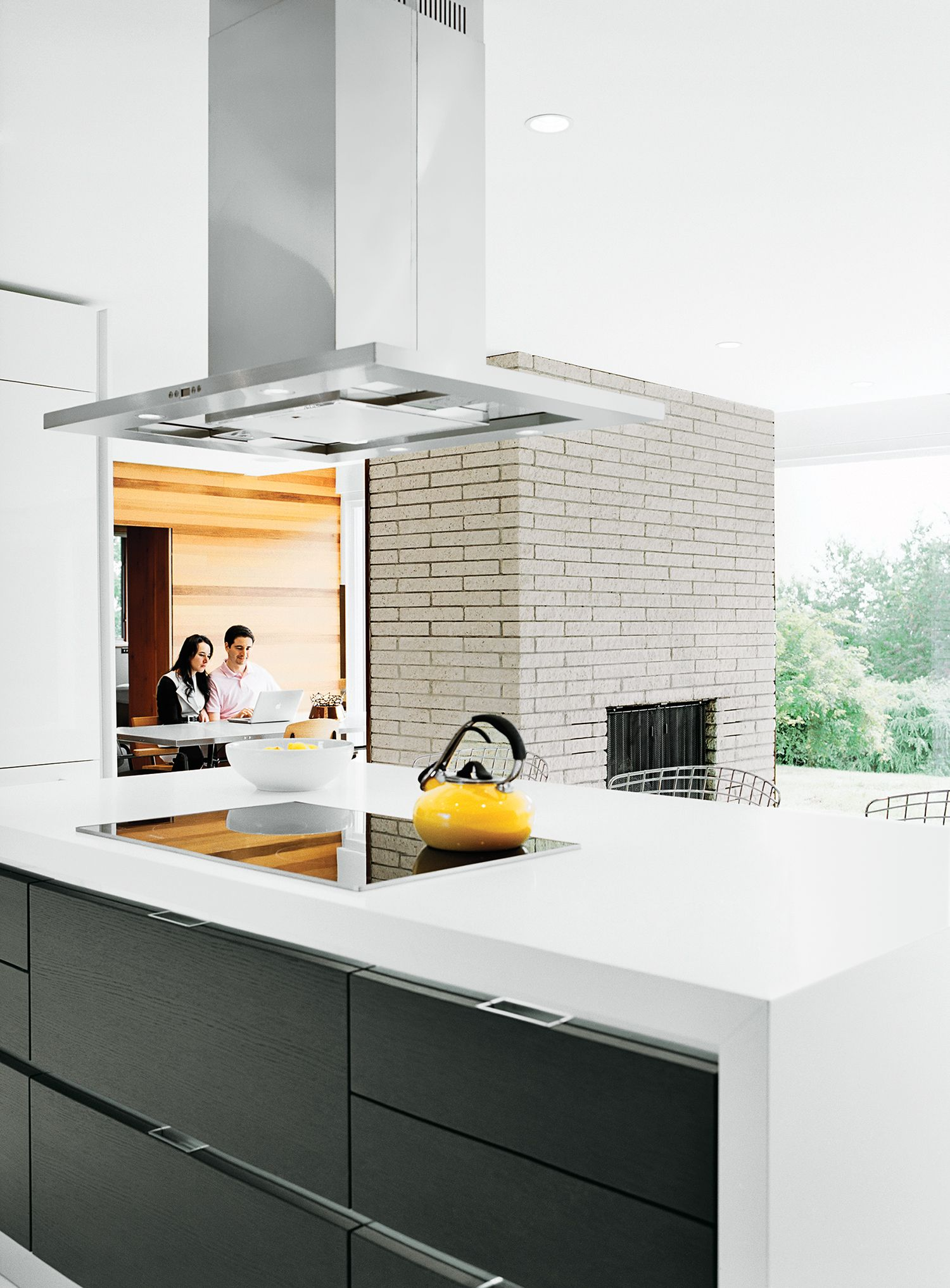 The cooktop and oven are Miele, the counter-top is Caesarstone, and ...