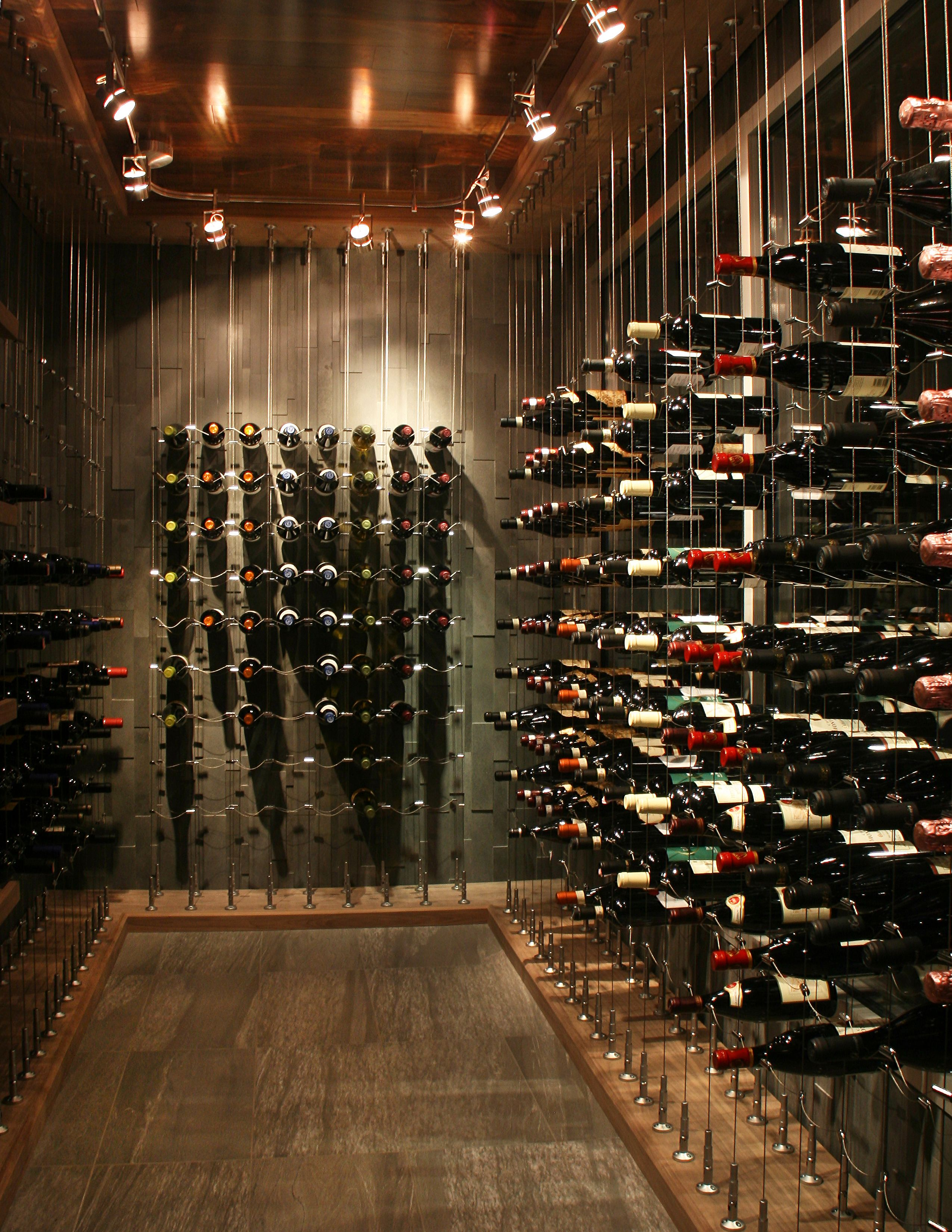 A Little Cable Goes A Long Way Check Out Cable Wine Systems Latest Custom Wine Cellar Weinkeller Design Weinkeller Und Weinlagerung