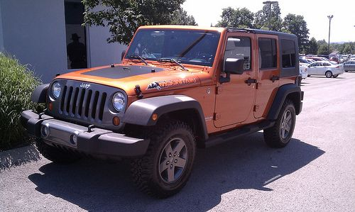 New Owner Wrangler Unlimited Mountain Edition In Mango Tango