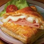 Homestyle Ham and Cheese Pockets - These hot and tasty homemade ham and Swiss cheese sandwich pockets are made easy with ready-to-use puff pastry squares.