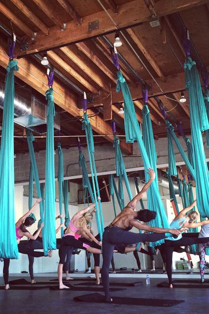 Get Pumped For 2015 At These Amazing Gyms Aerial Fitness Aerial Yoga Unique Workouts