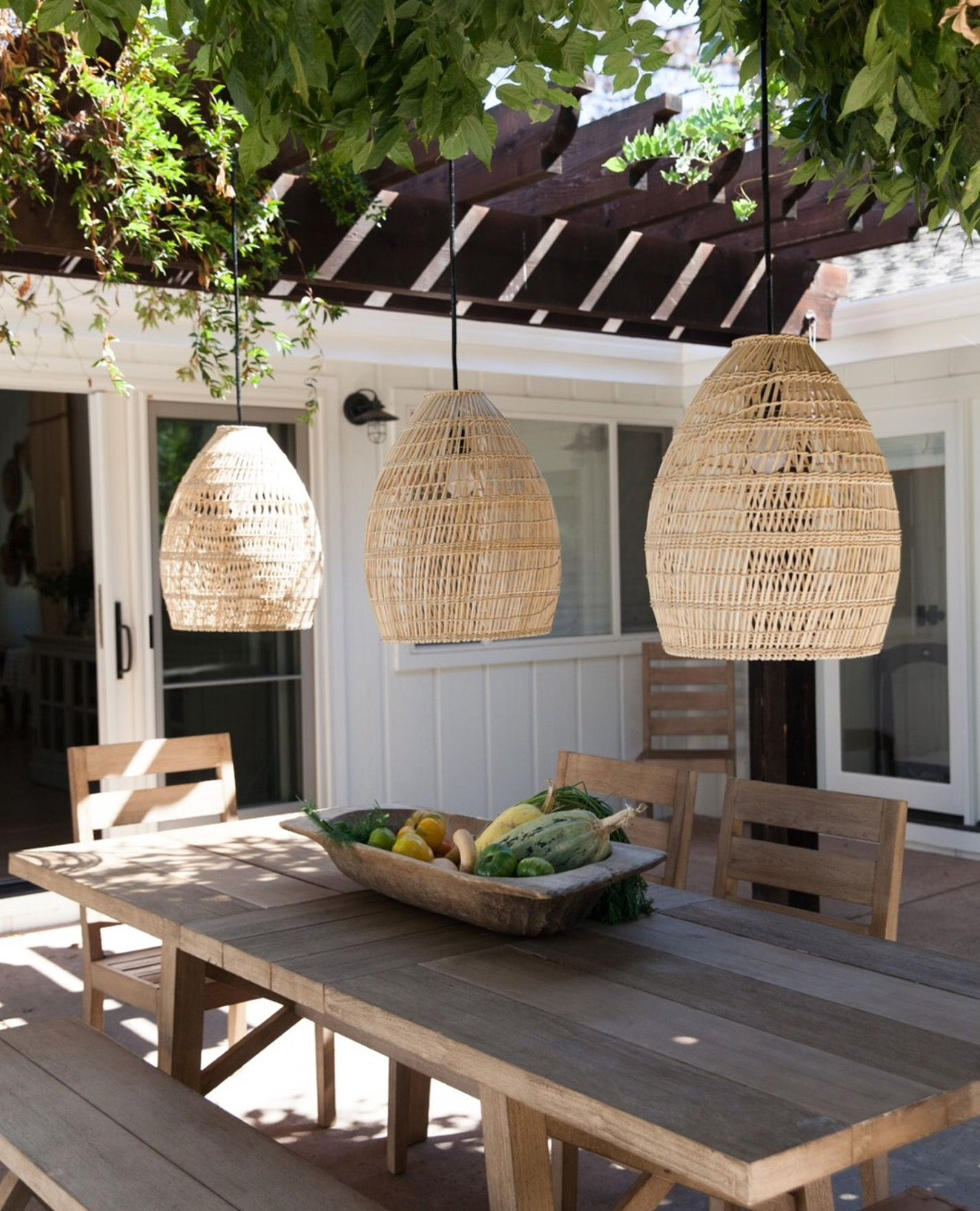 patio looks so cool comfortable with the gorgeous cane lights hanging above - Outdoor Patio Looks