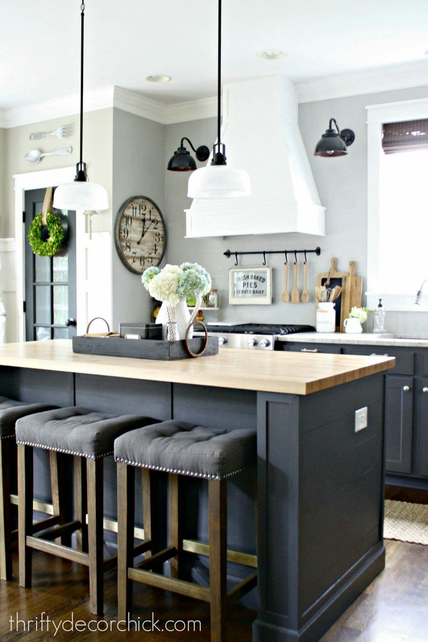 Light gray walls and dark gray cabinets kitchens in