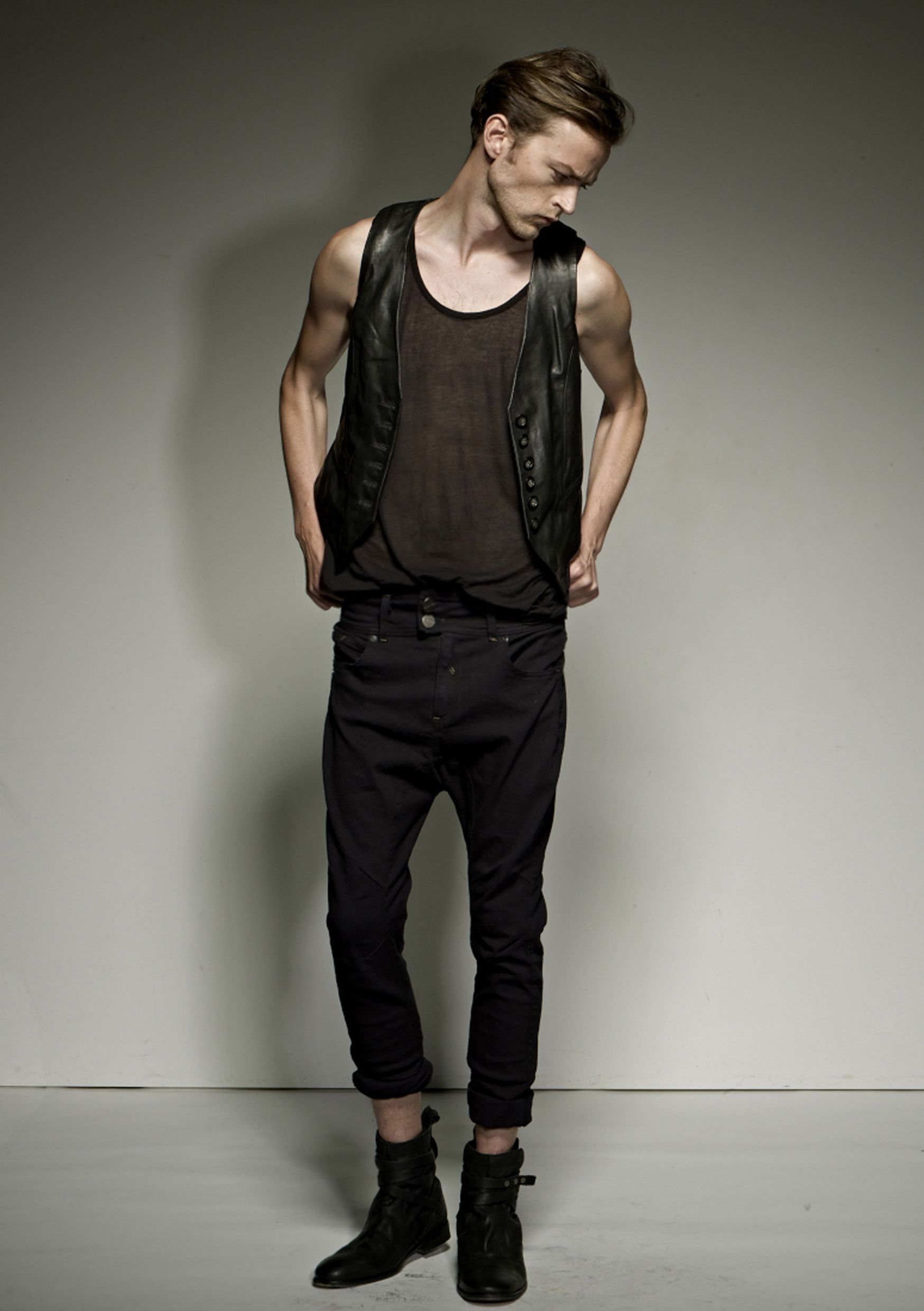 DZOJCHEN A/W12-13 Top: Lambskin leather button down vest & sheer tank Bottom: Black drop crotch jeans with racer panels